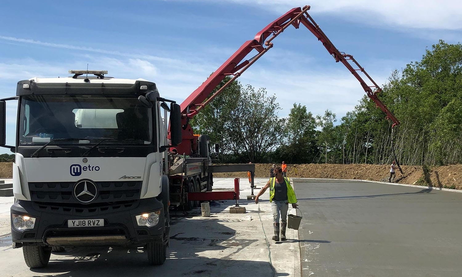 Concrete boom pump placing ready mixed concrete at a commerical site in Kent