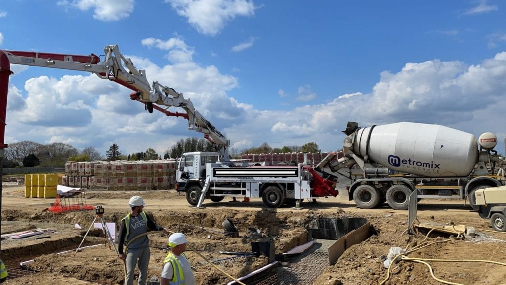 Large Concrete pour using a boom pump on site in Kent